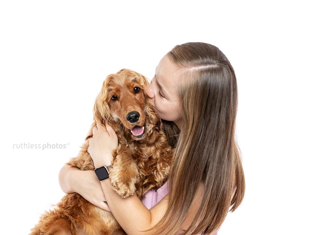 cocker spaniel dog and owner sharing a hug